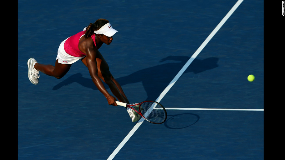 Sloane Stephens of the United States returns a shot during her women's singles second-round match against Tatjana Malek of Germany.
