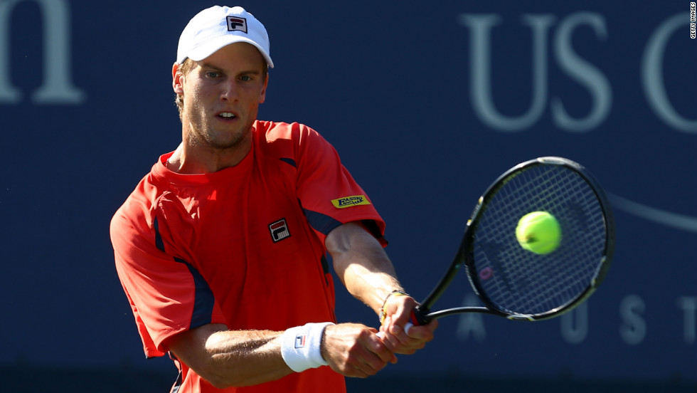 Italian Andreas Seppi hits a backhand during his men's singles first-round match against Spaniard Tommy Robredo.