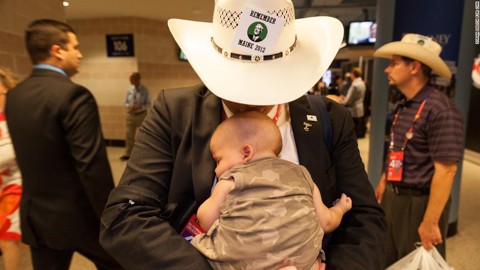 Texas delegate Read King kisses his son Benjamin on Thursday.
