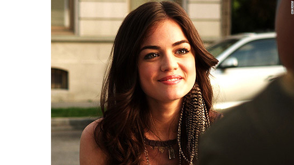 """""""I had just started the show, and I wanted every outfit to have my signature on it,"""" Line said. Because Aria's outfit seemed """"too tame,"""" Line said, she took this feather earring out of her ear and put it right into Aria's."""