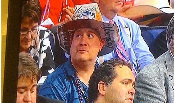 This man's hat made from a case of beer was posted on Twitter by @MichaelFHafner who captured it on Fox News.