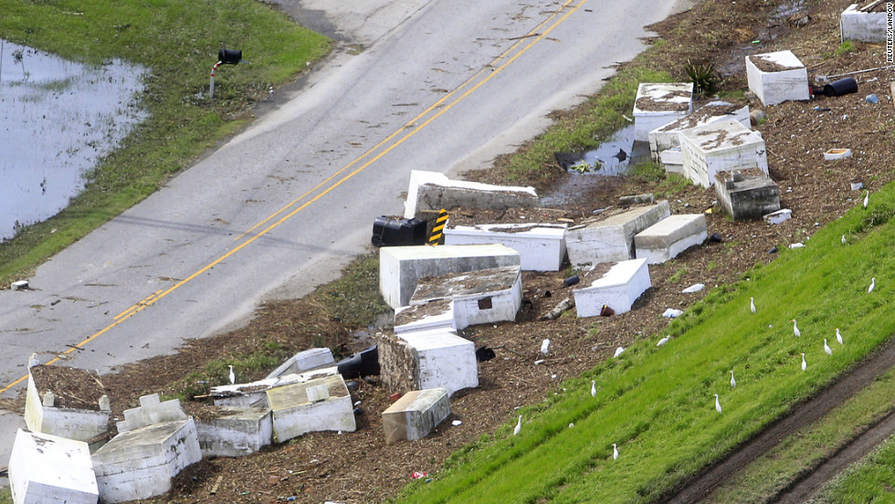 Tombstones washed from their resting place by flood waters from a levee breach in Braithwaite, Louisiana, on Friday.
