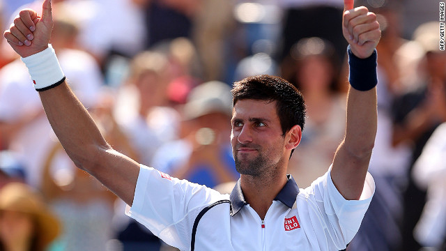Novak Djokovic takes the applause of the crowd at Flushing Meadows after his straight sets win over Rogerio Dutra Silva