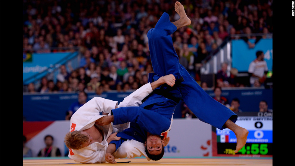 Ukrainian Dmytro Solovey, in white, and Mexican Eduardo Avila Sanchez compete in the Men's 73-kilogram judo semifinals.