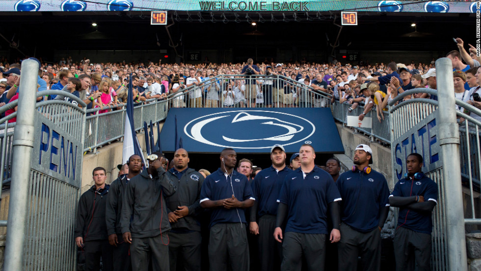 The Penn State football team prepares to take the field at the university's Football Eve pep rally Friday at Beaver Stadium.