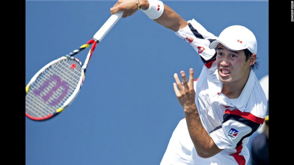 Kei Nishikori of Japan serves the ball to Marin Cilic of Croatia during a men's singles match.