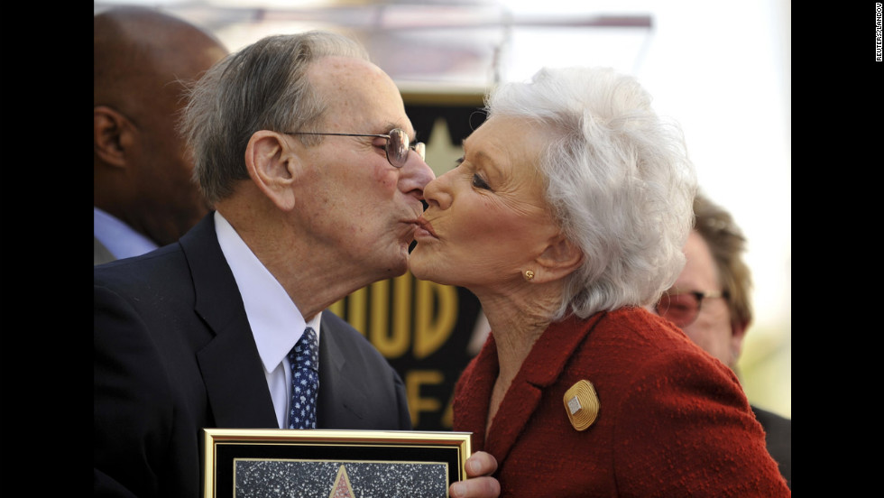 Eunice David gives her husband a kiss as the Hollywood Chamber of Commerce honors him with a star on the Hollywood Walk of Fame on October 14, 2011. It was his 90th birthday.