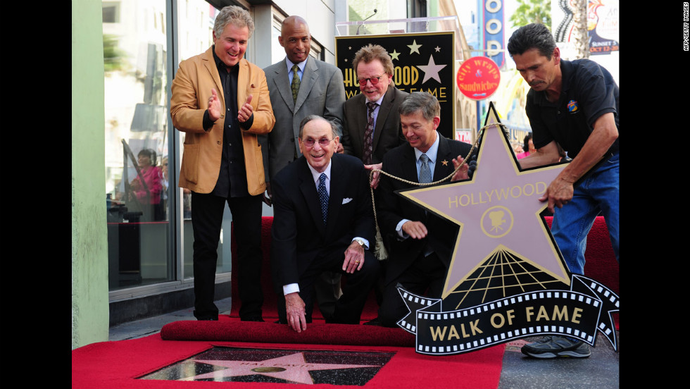 From left to right: Steve Tyrell, an unidentified guest, Paul Williams, and Leron Gubler pose with David after he was honored with his Hollywood star.