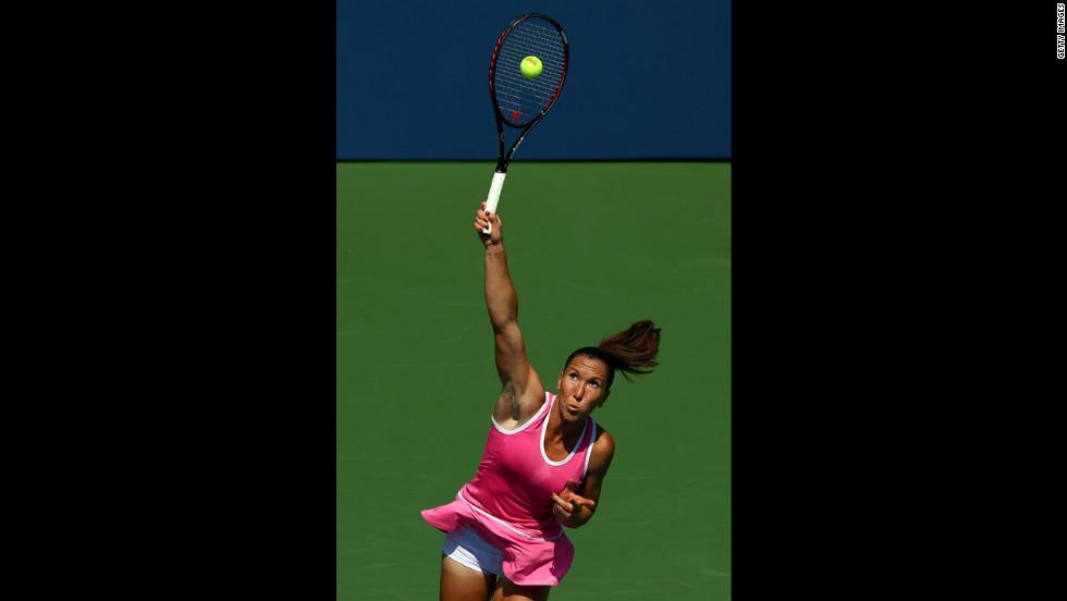 Serbian Jelena Jankovic serves against Poland's Agnieszka Radwanska.