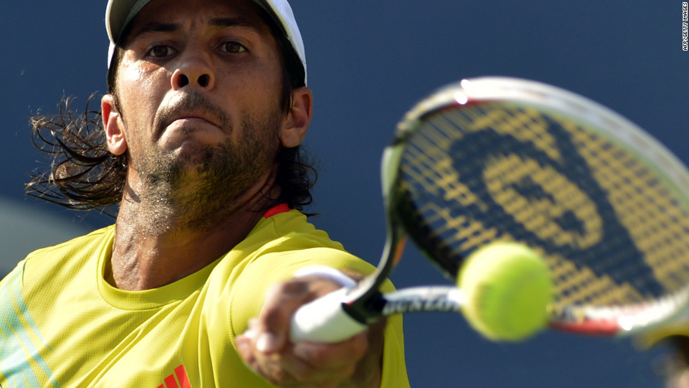 Fernando Verdasco of Spain returns a shot to top-ranked Roger Federer of Switzerland during their men's singles match at the U.S. Open on Saturday, September 1.