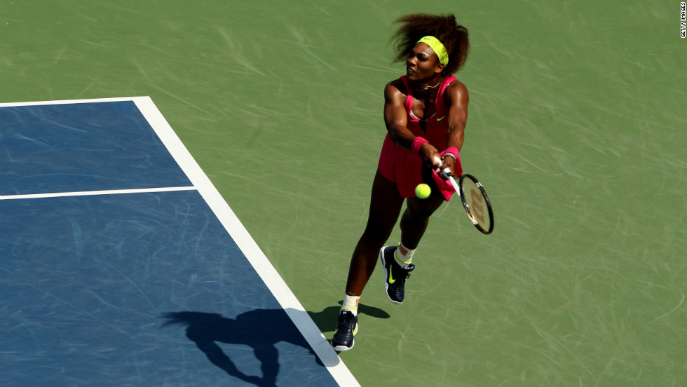 Serena Williams of the United States returns a shot against Russia's Ekaterina Makarova in their third-round singles match.