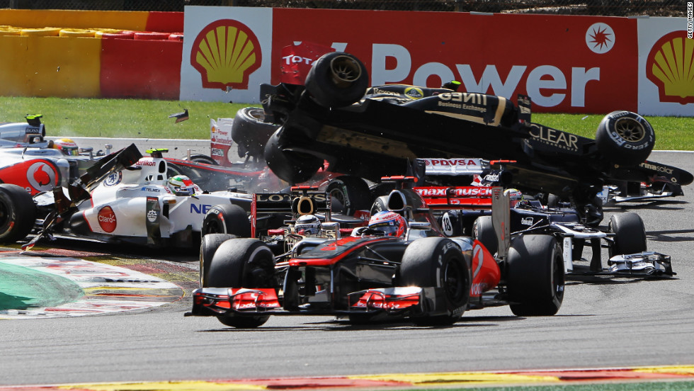A dramatic view of Grosjean flying over cars on the first corner of the Belgian Grand Prix at Spa-Francorchamps.