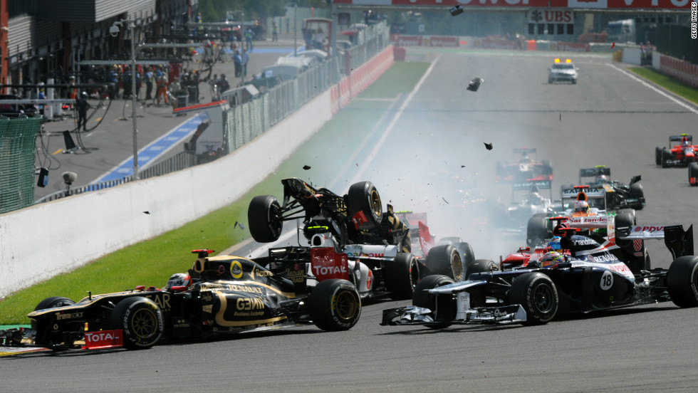 Grosjean's Lotus is flipped upwards after the initial collision and is about to be catapulted into the air.
