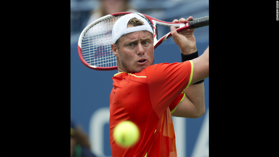 Lleyton Hewitt of Australia hits a return to David Ferrer of Spain during their men's singles match Sunday.