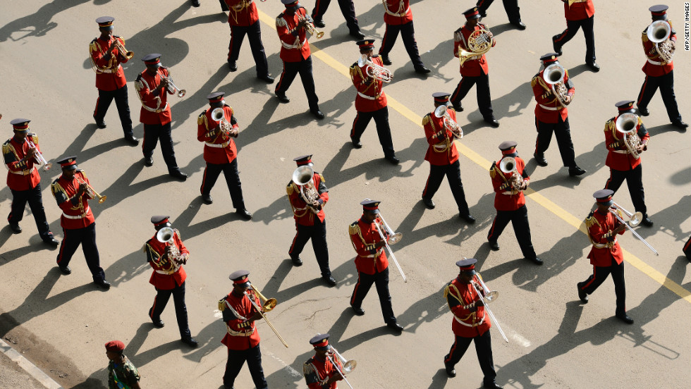 A marching band plays as the cortege moves through the streets of Addis Ababa.