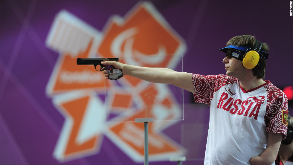 Russia's Sergey Malyshev shoots during the mixed 25-meter pistol final on Monday.
