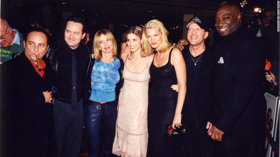 "In 2000, Duncan was cast in the crime comedy ""The Whole Nine Yards."" He is seen at the premiere with co-stars, from left, Kevin Pollak, Matthew Perry, Rosanna Arquette, Amanda Peet, Natasha Henstridge and Bruce Willis."