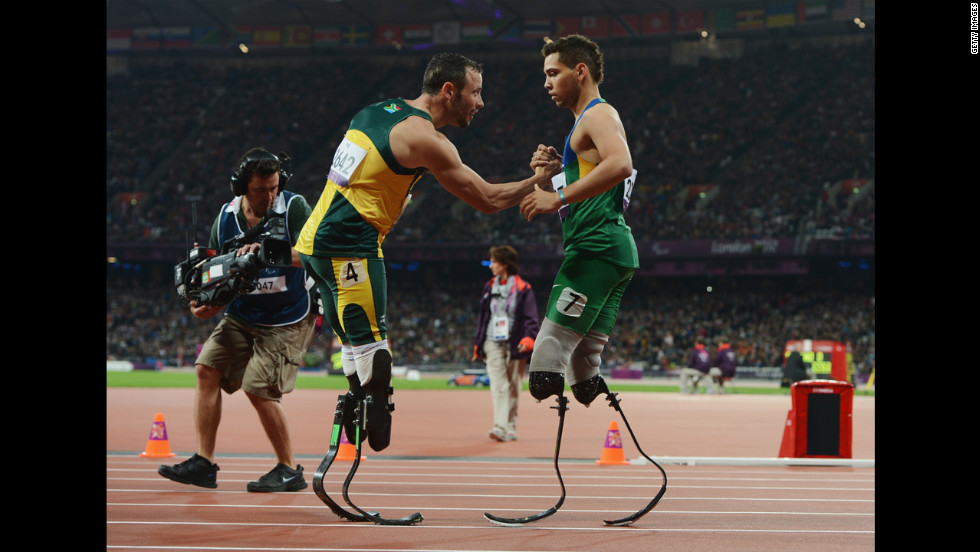 Oliveira is congratulated by Pistorius at the end of the men's 200-meter T44 race.
