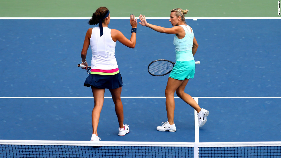 Julia Goerges, left, of Germany and Kristyna Pliskova of the Czech Republic react after a point against Sara Errani and Roberta Vinci of Italy on Tuesday.