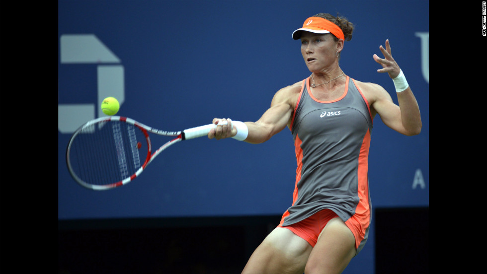 Samantha Stosur of Australia makes a return shot in her women's singles match against  Victoria Azarenka of Belarus.