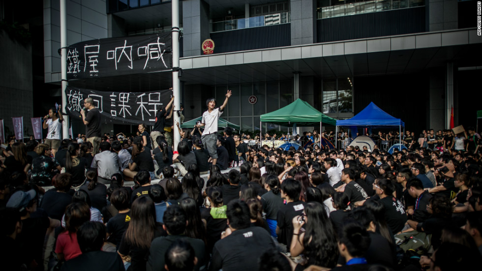 Students shout slogans in front of the Central Government Offices in Hong Kong on September 3, 2012.