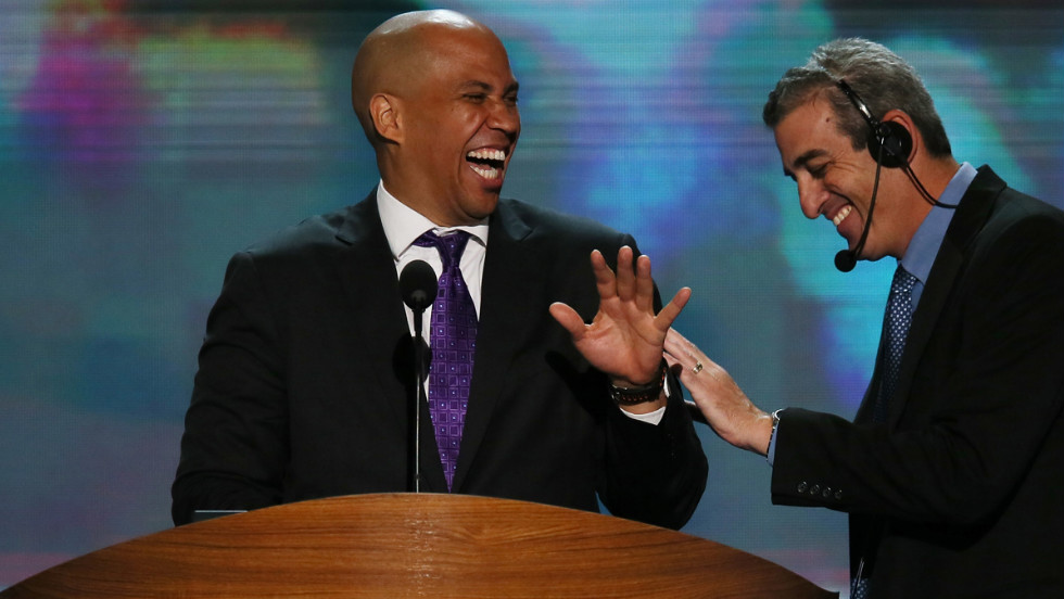 Newark Mayor Cory Booker, left, laughs with stage manager David Cove during a walk-through on Tuesday.
