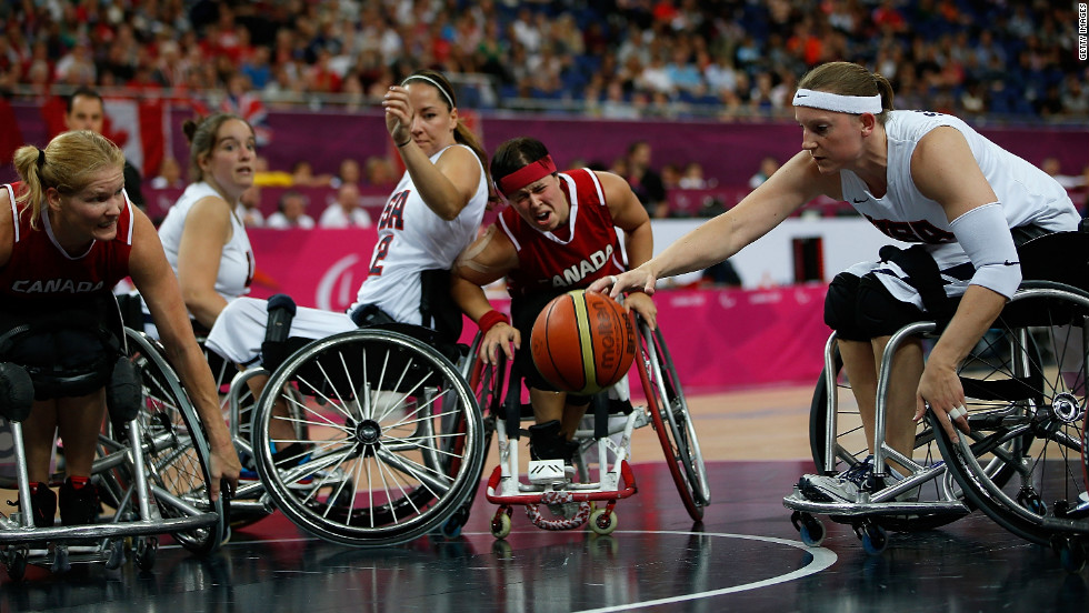 Natalie Schneider of the United States reaches for the ball in the women's wheelchair basketball quarterfinals against Canada on Tuesday.