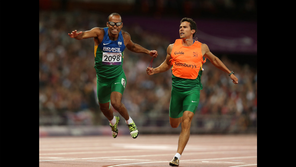 Daniel Silva of Brazil and guide Heitor de Oliveira Sales win silver in the men's 200-meter  - T11 final on Tuesday.