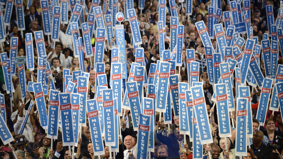 A sea of signs welcomes the first lady onto the stage Tuesday at the Time Warner Cable Arena.