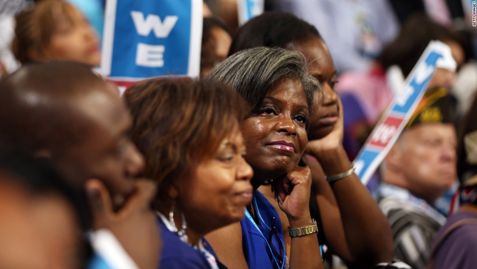 Delegates listen to Michelle Obama's speech Tuesday. The first lady offered a personal perspective on why her husband should be re-elected.