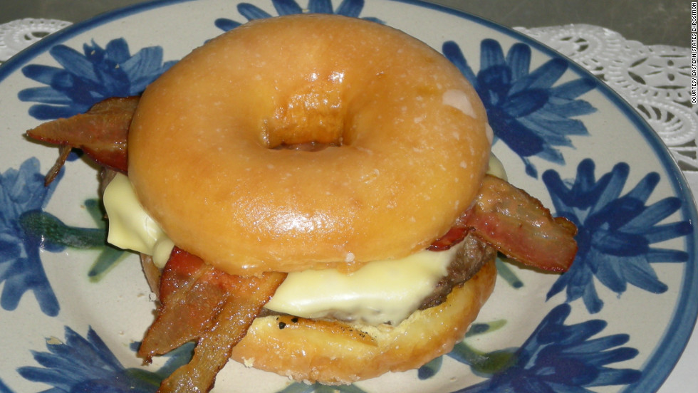 "The Big E, or Eastern States Exposition, in West Springfield, Massachusetts, is home to the Craze-E Burger, which was introduced in 2009. It's ""a huge hamburger, topped with melting cheese and crispy bacon, all served on a grilled, glazed donut."""