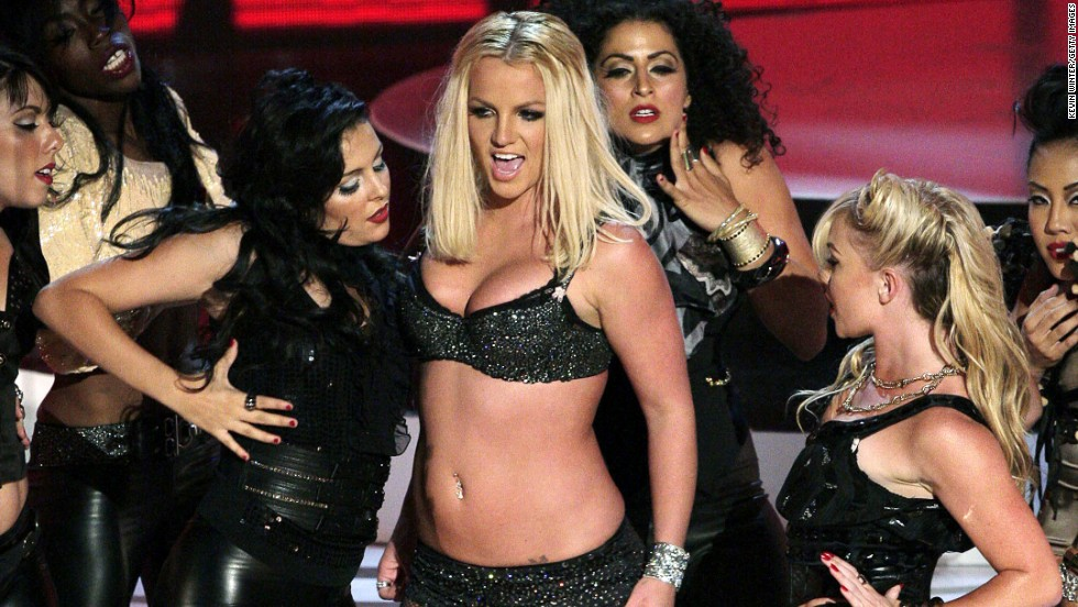 "After shaving her head and seeking treatment in early 2007, Britney Spears' VMA performance was touted as her ""comeback."" However, the singer's awkward ""Gimme More"" performance was met with critical reviews. Time said the usually confident Spears looked ""tired, nervous, uncomfortable, aloof and out of place."""