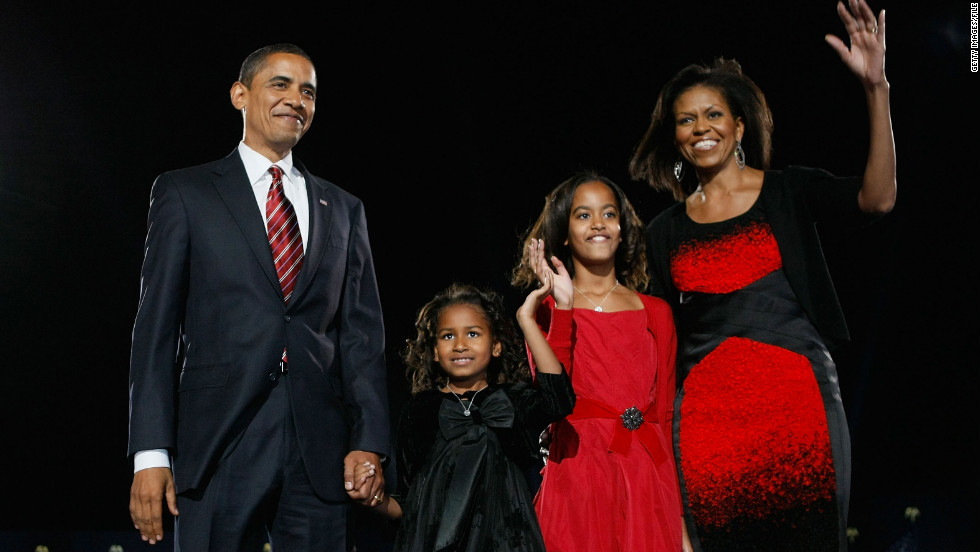 President-elect Obama stands on a stage with the future first family during an election night gathering in Grant Park on November 4, 2008, in Chicago.