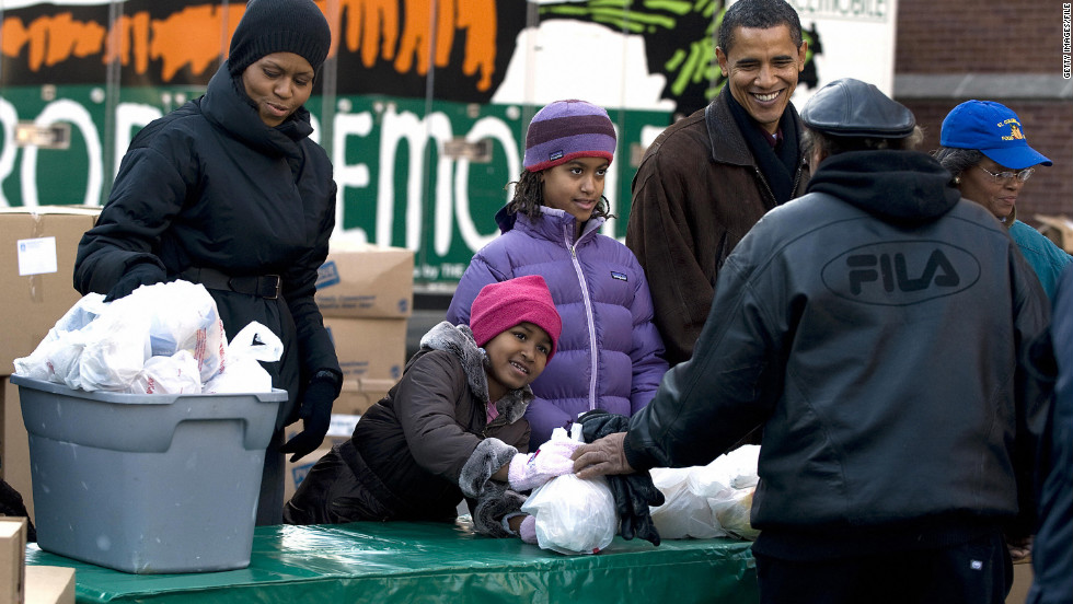President-elect Barack Obama and his family hand out food for Thanksgiving during a surprise visit to St. Columbanus Parish and School in Chicago on November 26, 2008.