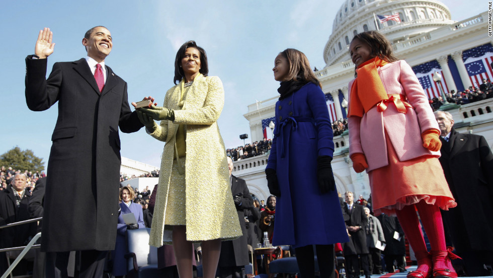 Barack Obama takes the oath of office with wife Michelle by his side and daughters Sasha, far right, and Malia standing close by on January 20, 2009.