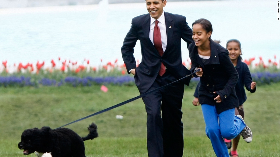 President Obama with his daughters and new dog Bo, during the dog's introduction to the White House press corps on the South Lawn of the White House on April 14, 2009. The six-month-old puppy was a gift from the late Sen. Edward M. Kennedy.