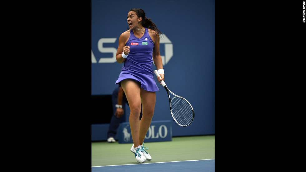 France's Marion Bartoli reacts to a point against Maria Sharapova of Russia on Wednesday.