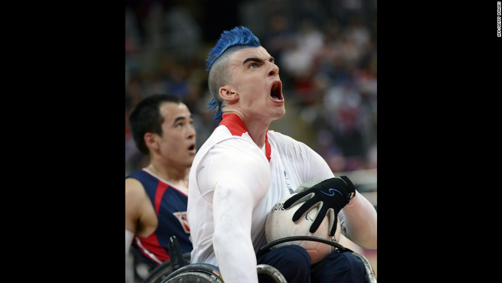 Britain's David Anthony, center, reacts to scoring a goal against the United States during a Pool A wheelchair rugby match on Wednesday.