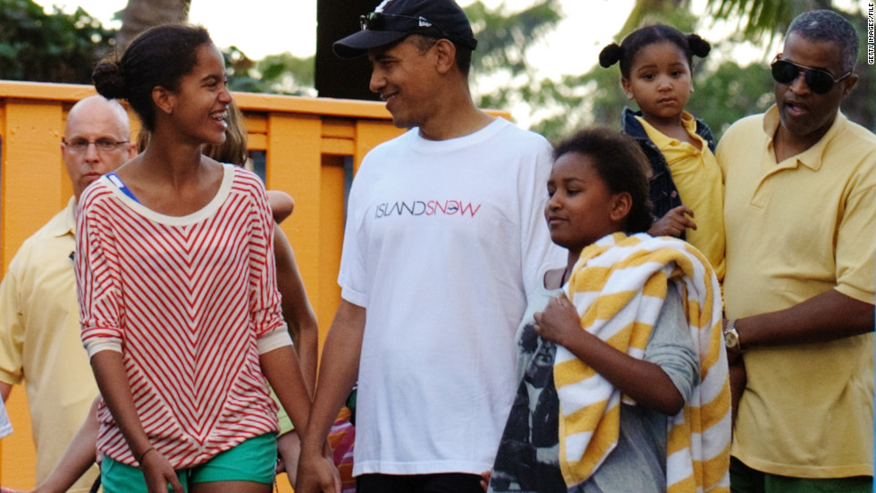 President Obama walks with daughters Malia and Sasha after a visit to Sea Life Park December 27, 2011, at Waimanalo, Hawaii.