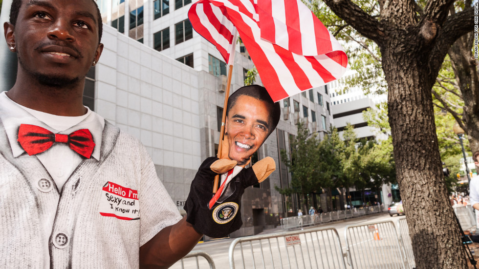 A man sells Obama puppets at the convention on Wednesday.