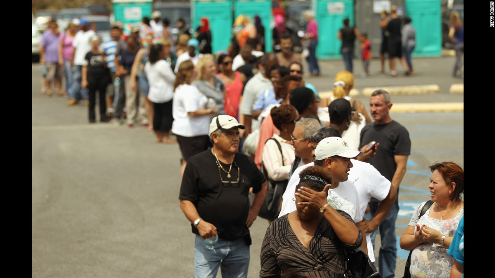 Residents wait in line to apply for disaster food assistance on Wednesday in Westwego, Louisiana.