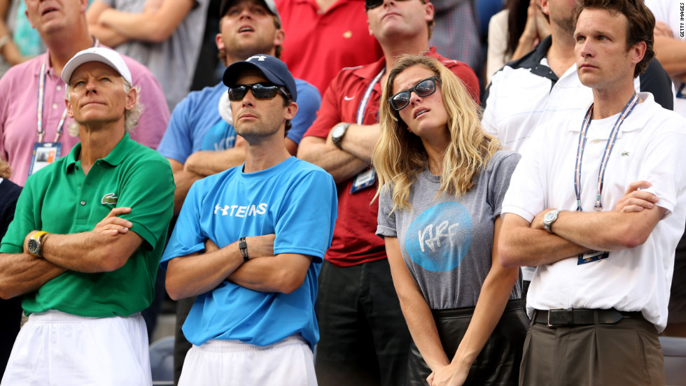 Coach Larry Stefanki, left trainer Doug Spreen, wife Brooklyn Decker and agent Graham Cross watch Roddick in his final match on Wednesday.