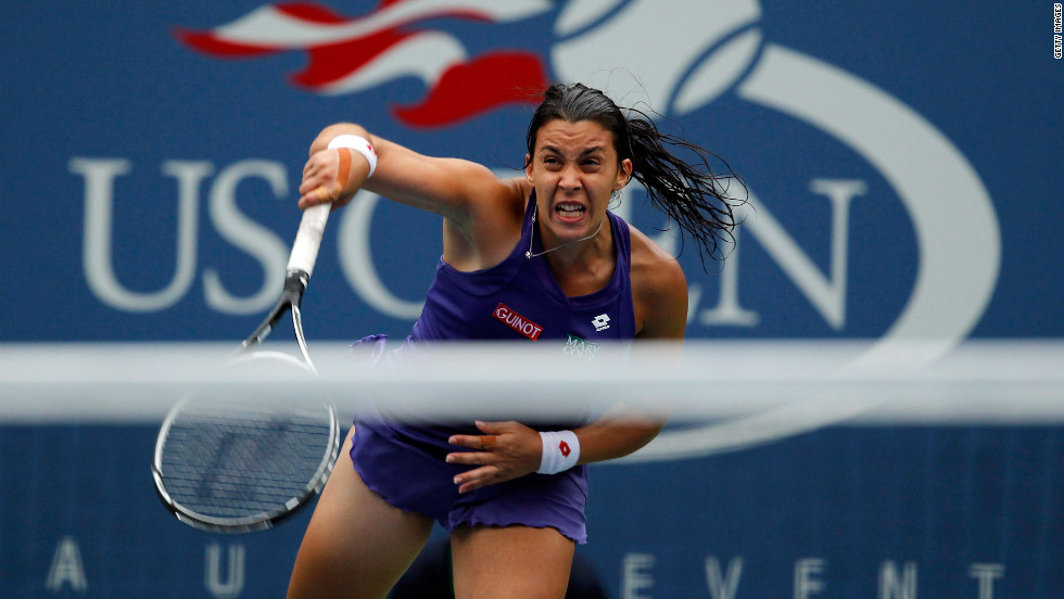 Bartoli returns a shot against Sharapova on Wednesday.