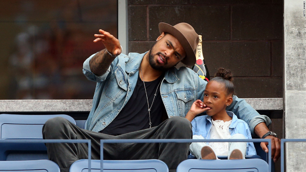 NBA basketball player Tyson Chandler and his daughter Sacha-Marie attend the U.S. Open on Wednesday.