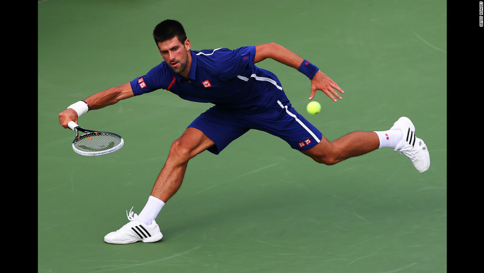 Serbia's Novak Djokovic pulls back to return a shot to Stanislas Wawrinka of Switzerland during his men's singles fourth-round match on Wednesday.