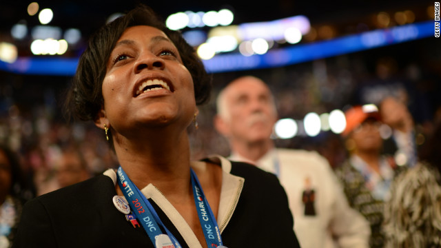 A delegate listens to a speech about women's rights at the Time Warner Cable Arena in Charlotte on the first night of the DNC.