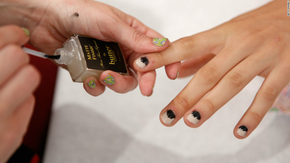 A model sports a two-toned manicure by butter LONDON for the Kaeleen Spring 2013 fashion show.