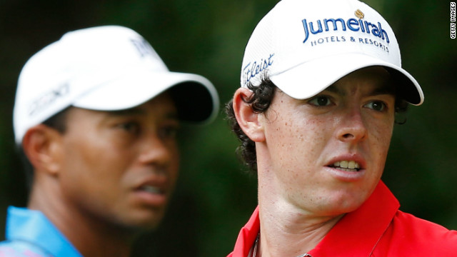 Rory McIlroy on the fifth tee at Crooked Stick with Tiger Woods in the background.