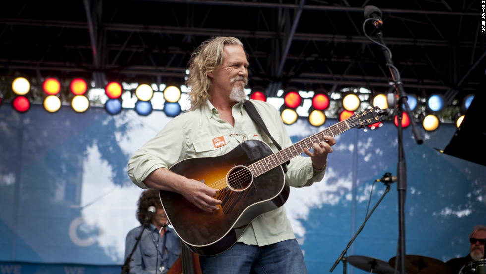 Actor and musician Jeff Bridges performs for the convention crowd. Bridges, an Obama supporter, also attended and performed in Tampa, Florida, last week during the Republican National Convention seeking support for his fight against child hunger.