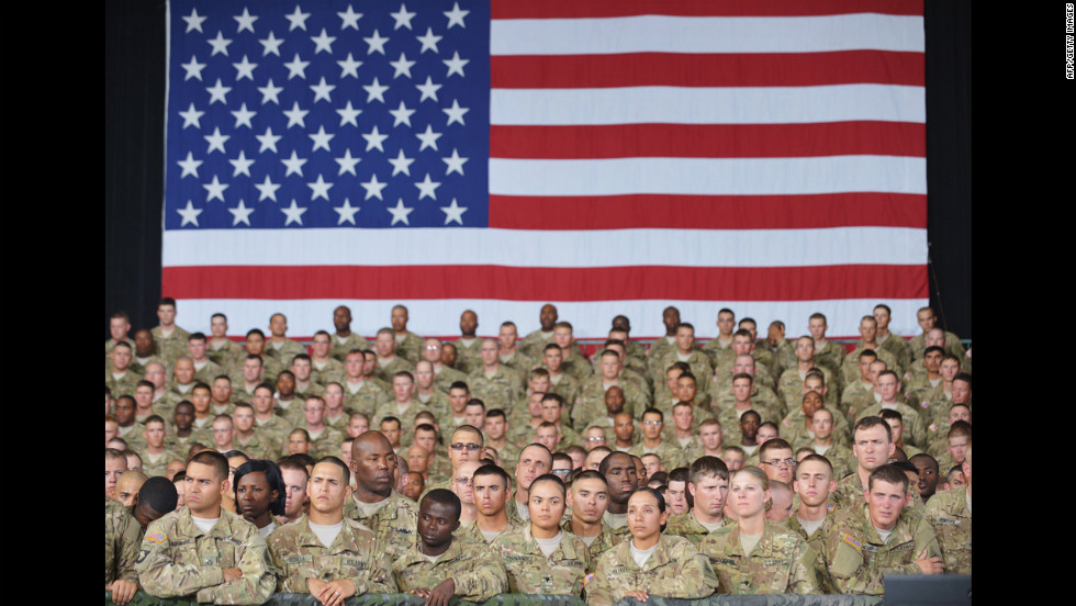 Troops await the arrival of the president for an address inside the 1st Aviation Support Battalion Hangar on Friday, August 31, at Fort Bliss, Texas.